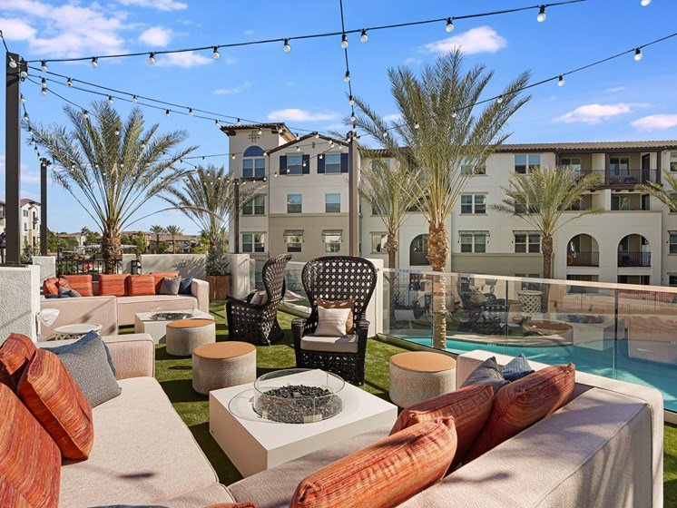 Outdoor Lounge for Entertaining Overlooking Resort Pool at The Club at Enclave Apartments in Chula Vista, CA