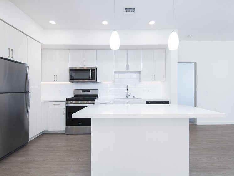 Modern Kitchen Lights At The Club At Enclave Apartments In Chula Vista, CA
