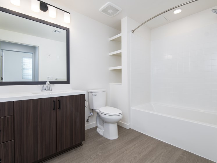 Modern Bathrooms With Ample Storage At The Club At Enclave Apartments In Chula Vista, CA