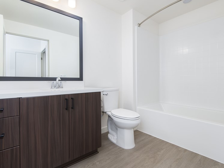 Modern Bathrooms With White Quartz Countertops At The Club At Enclave Apartments In Chula Vista, CA
