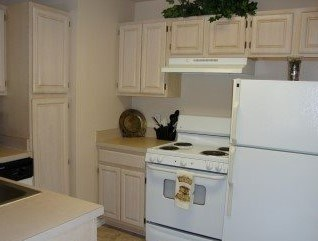 Kitchen with white appliances and light cabinetry