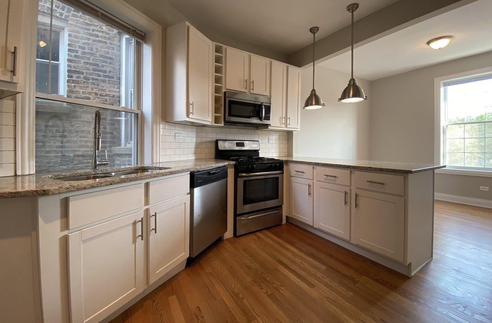 Stunning kitchen space with hardwood floors