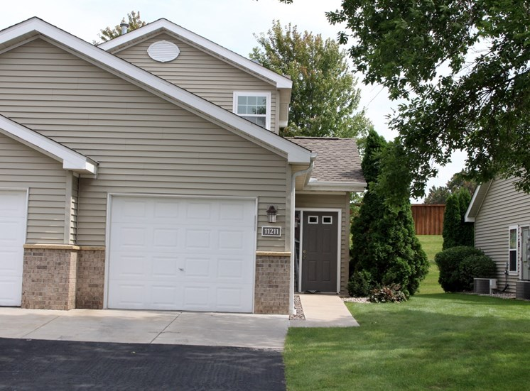 exterior of 1 bedroom single car garage townhome and private entry