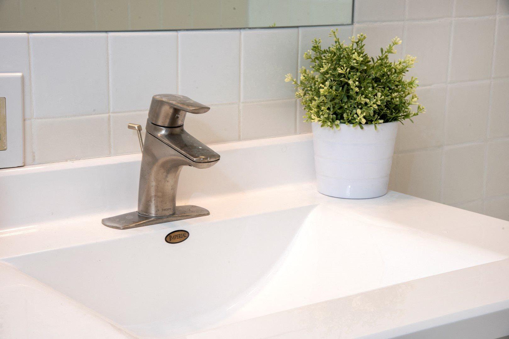 White Tile Back Splash and Deep Sink in Bathroom of Minneapolis Apartment
