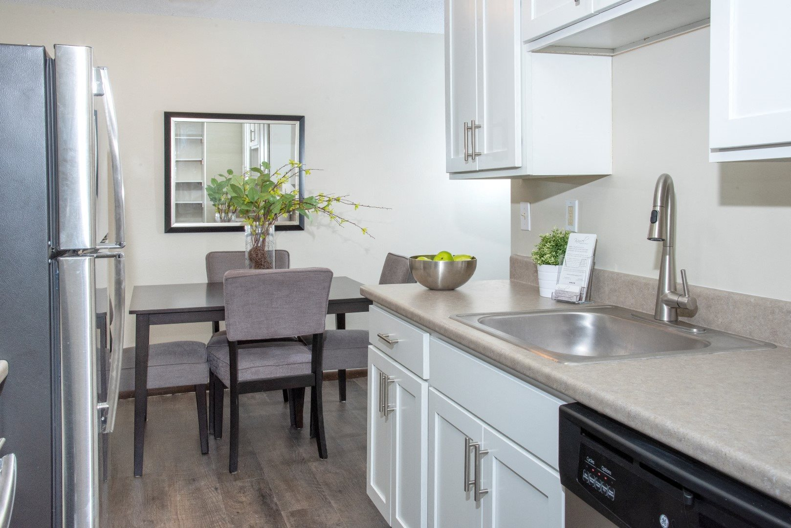 600 10th Ave Apartment Kitchen with Stainless Steal Appliances and White Cabinetry