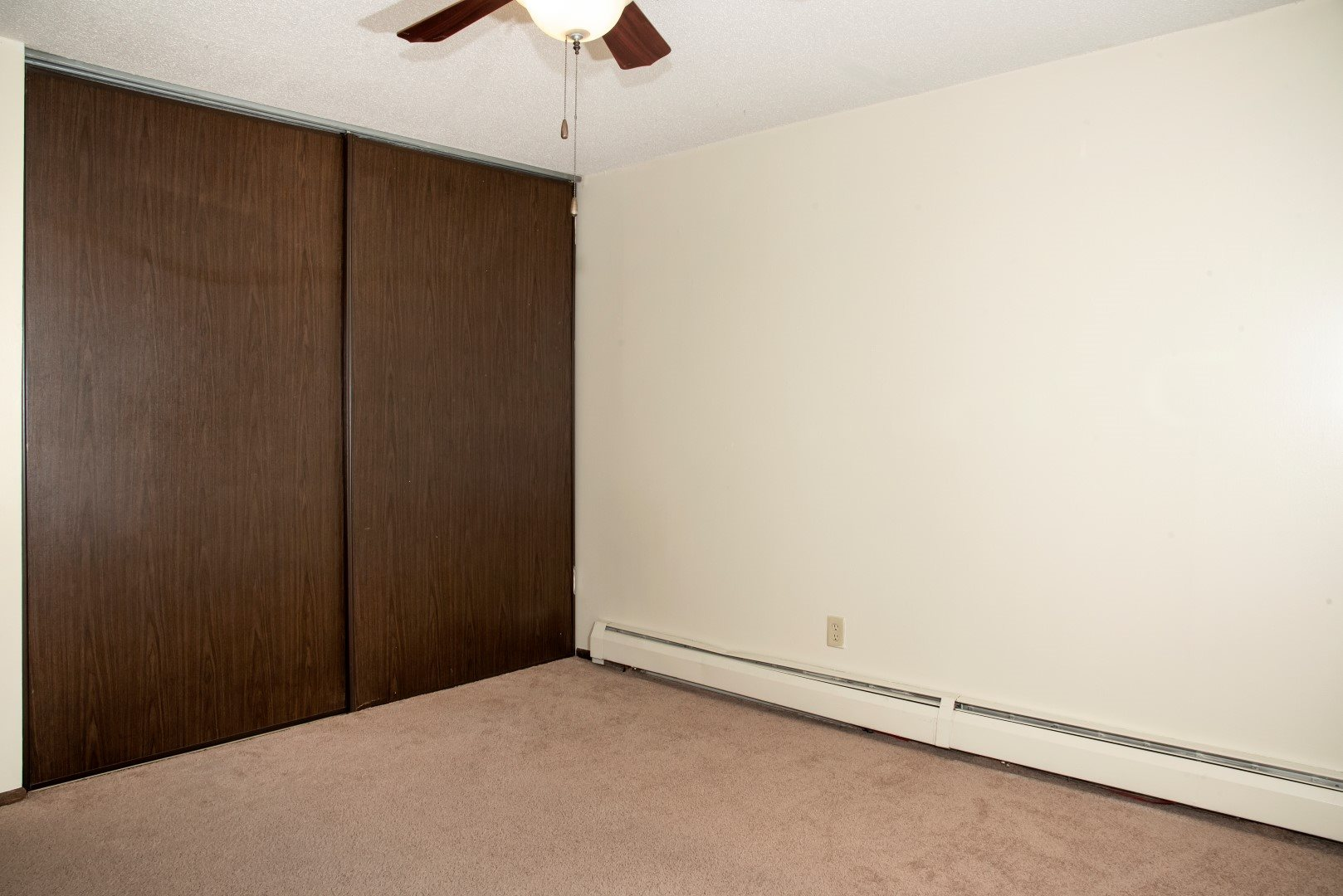 first bedroom, spacious closets, ceiling fan