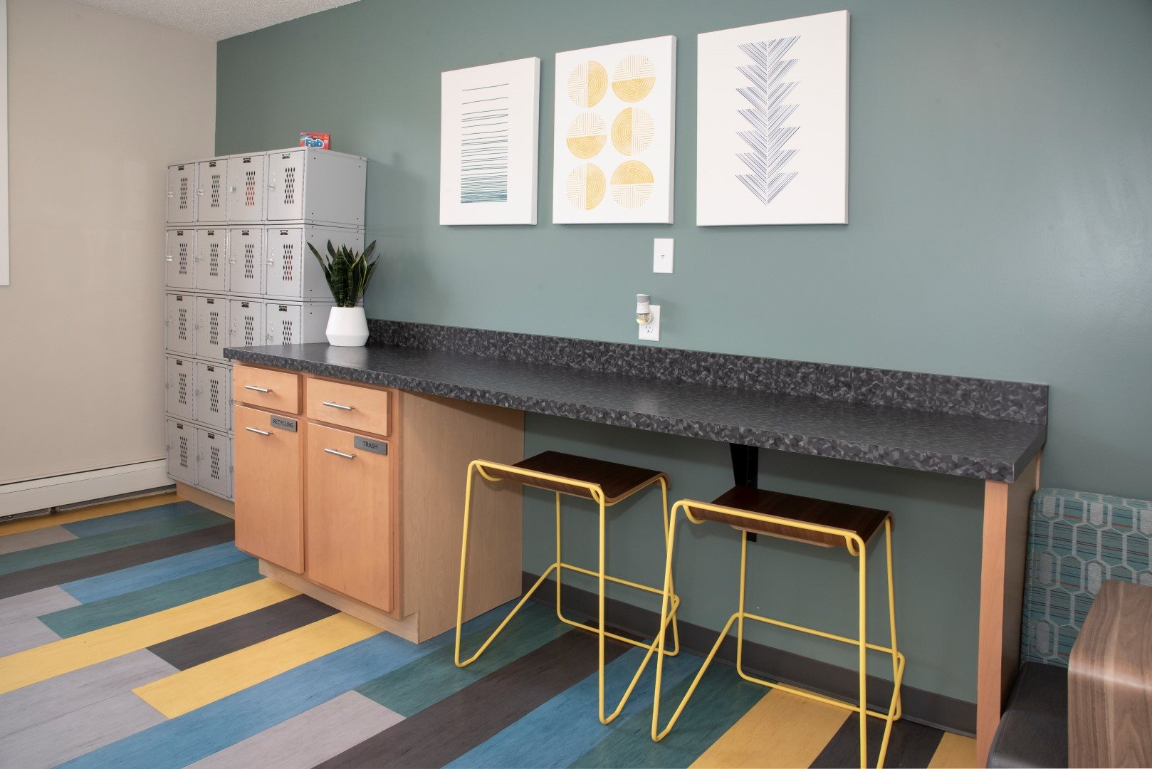 laundry lounge with lockers for laundry storage