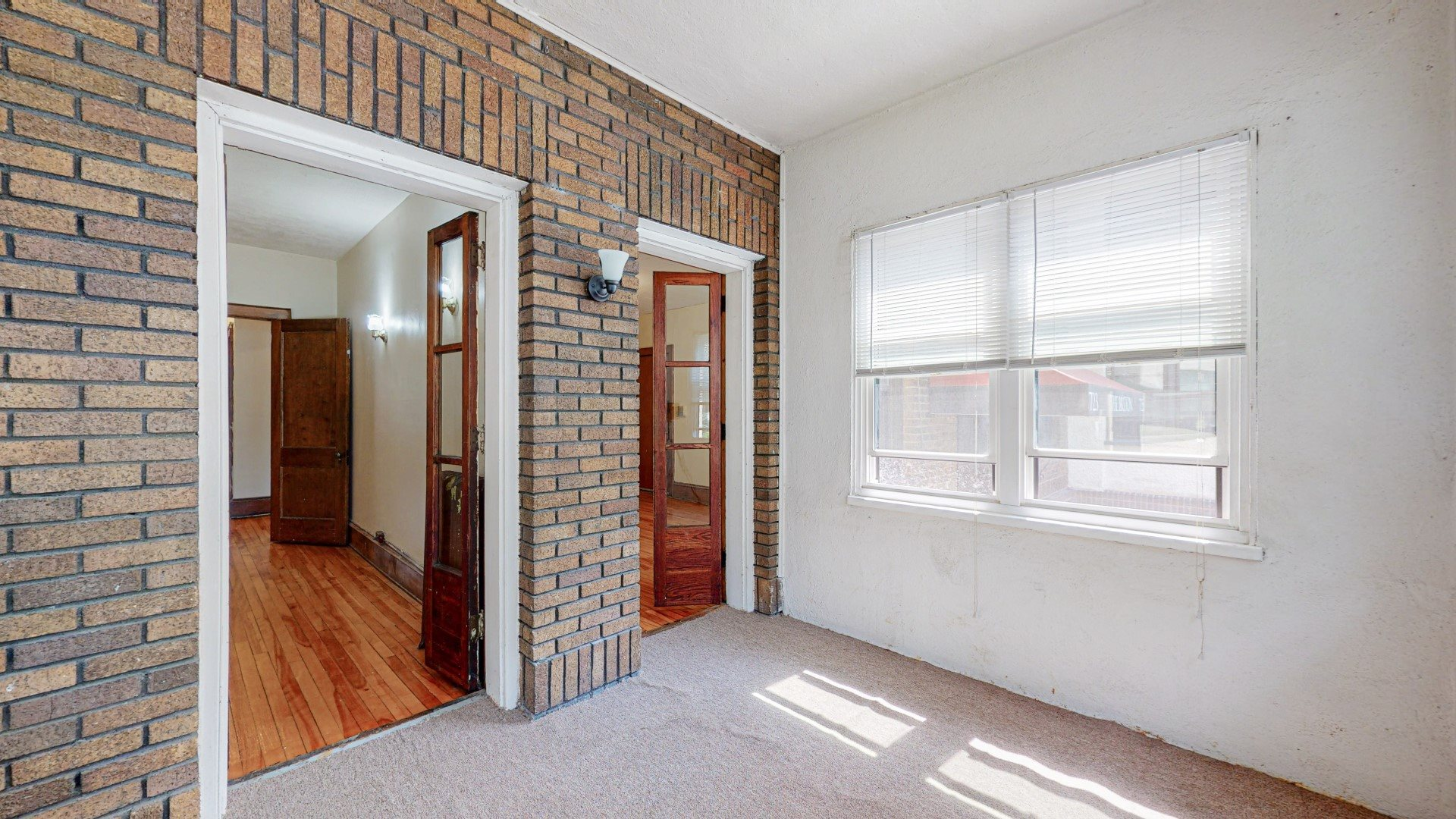Sibley_3br_porch with exposed brick