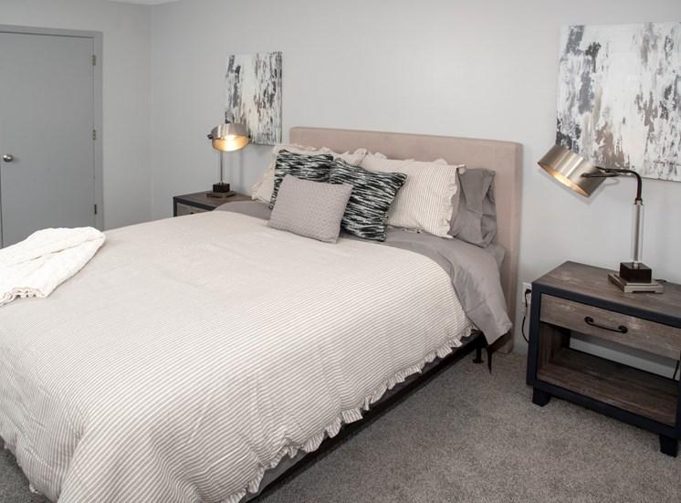 Bedroom 2 with bedroom set, night stands and walk in closet