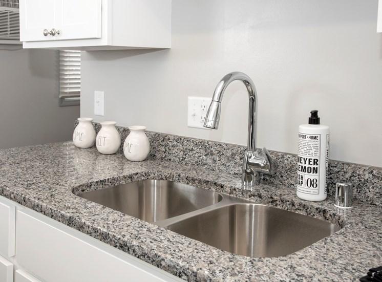 Granite countertops with new plumbing fixtures