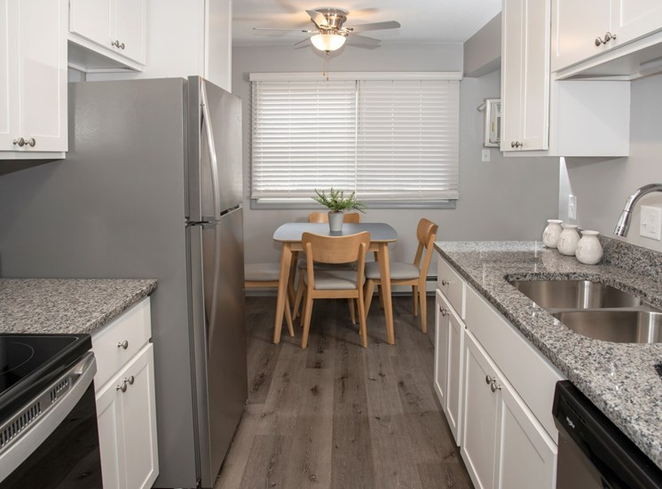 galley style kitchen with new finishes and dining area