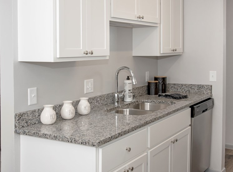 new white cabinetry, granite countertops, full appliance package