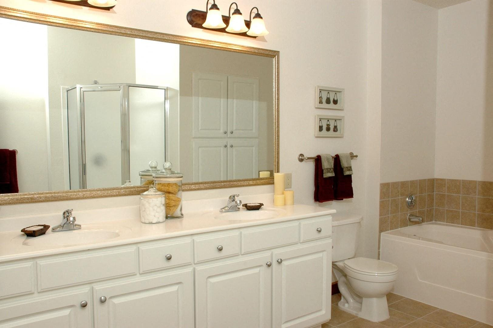 large bathroom with double vanity in select homes