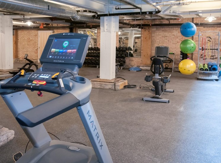 Fitness Center with Multiple Fitness Machines and Materials at 700 Central Apartments, 700 Central Avenue, Minneapolis