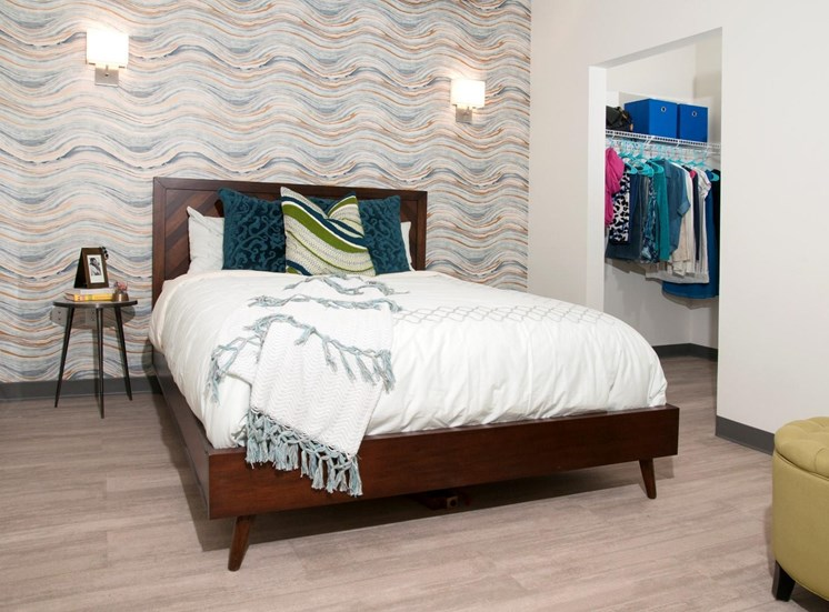 Large Master Bedroom with Spacious Walk-in Closet and Light Wood Floors at 700 Central Apartments, MN, 55414
