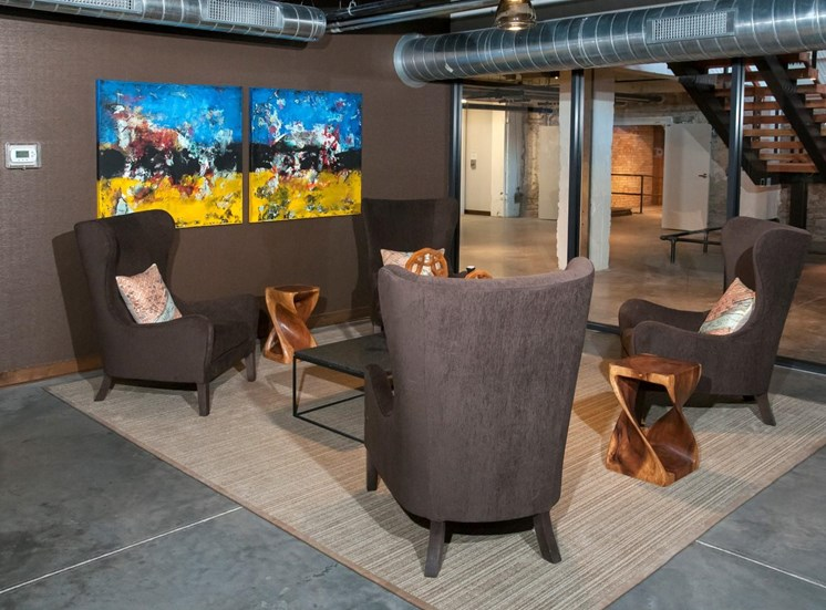 Over-Sized Chairs Around Large Table in Seating area at 700 Central Apartments