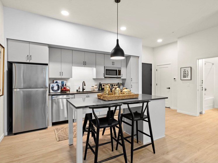 Fitted Kitchen With Island Dining at The Hill Apartments, Saint Paul, MN, 55103