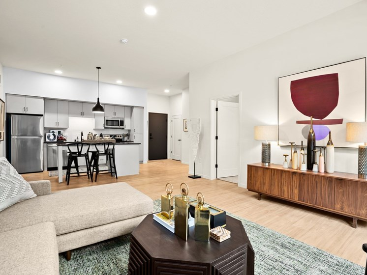 Modern Living Room With Kitchen View at The Hill Apartments, Saint Paul, MN
