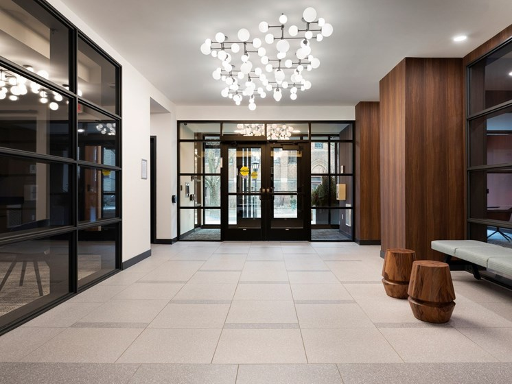 Lobby Entrance with Modern Decor and Lighting at The Hill Apartments in St Paul, MN