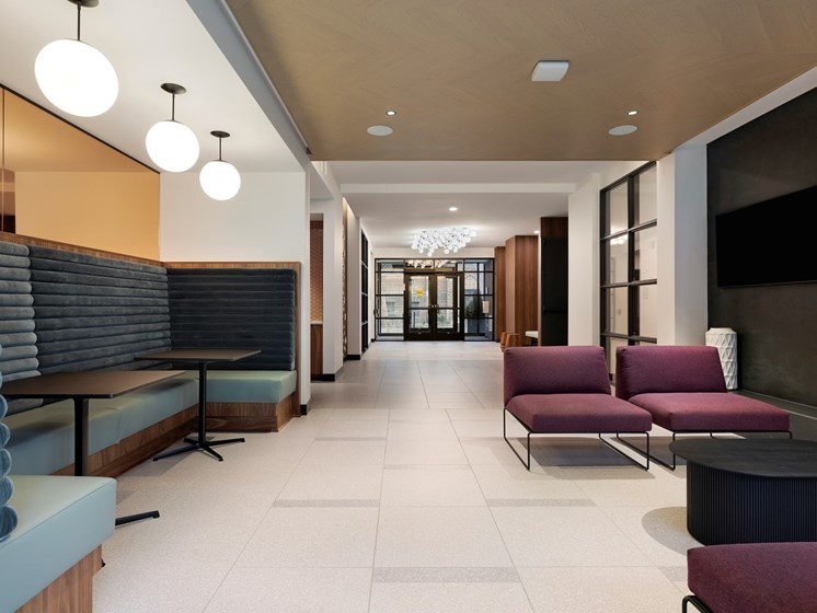 Inviting Lobby Area with Plenty of Seating at The Hill Apartments in St Paul, MN