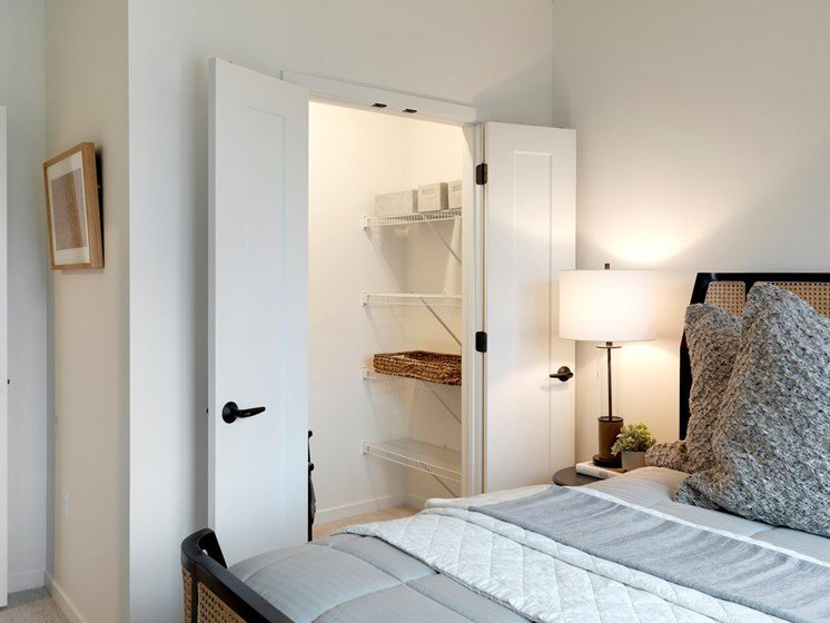 Bedroom with Spacious Closet Space and Lighting at The Hill Apartments in St Paul, Minnesota