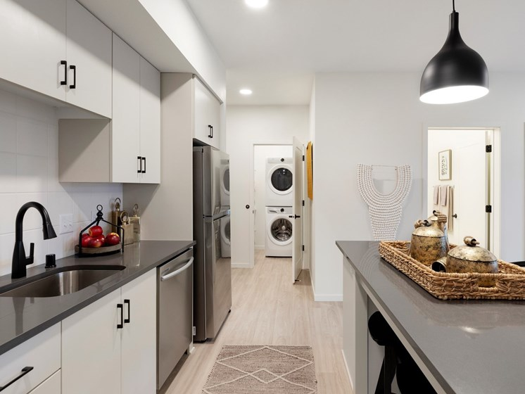 Large Kitchen Space With Modern Details and Efficient Appliances at The Hill Apartments in Minneapolis, MN