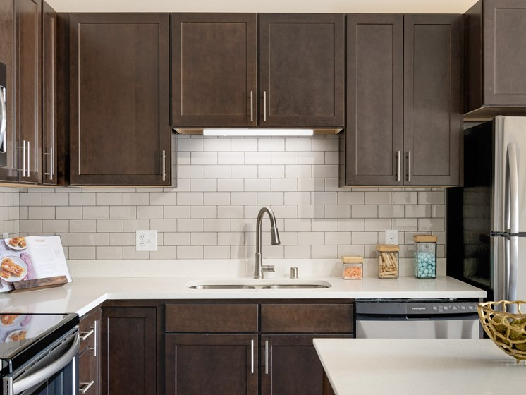 Dark espresso Kitchen Cabinets at The Sixton Apartments Shakopee MN