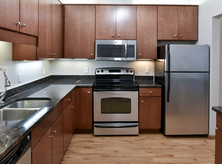 traditional kitchen with cherry cabinets and dark granite countertops