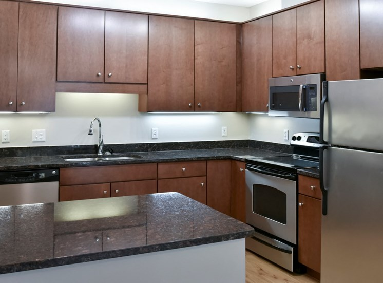 traditional kitchen with cherry cabinets and dark granite countertop