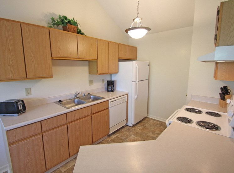 This is photo of the kitchen of the 852 square foot 1 bedroom Fairlawn at Trails of Saddlebrook Apartments in Florence, KY.