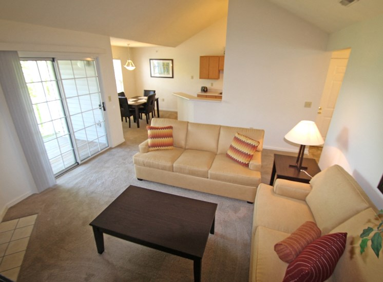 This is photo of the living room of the 852 square foot 1 bedroom Fairlawn at Trails of Saddlebrook Apartments in Florence, KY.