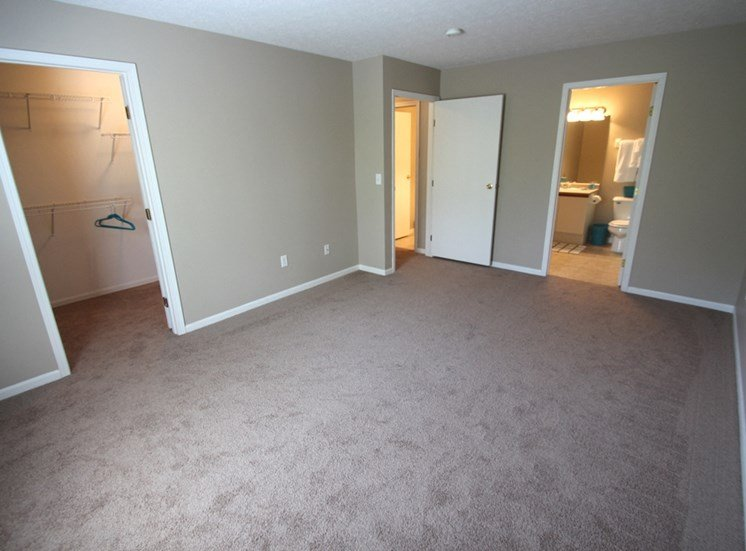 This is a photo of the master bedroom in the 1170 square foot 2 bedroom Freedom Balcony at Washington Place Apartments in Washington Township, OH.