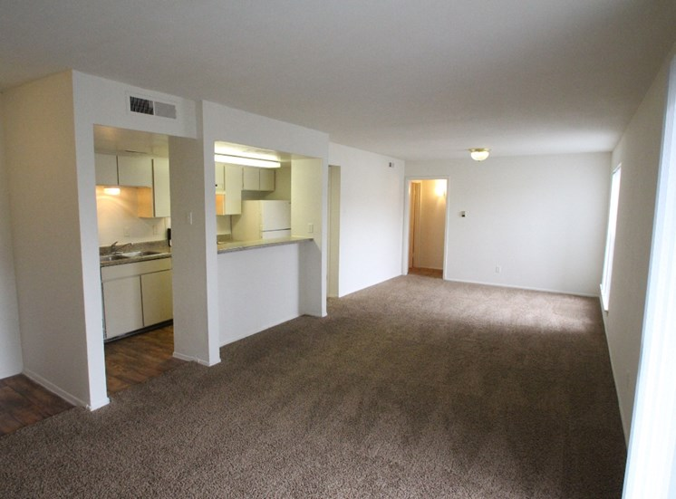 This is a photo of the living room/kitchen area of the 1007 square foot 2 bedroom apartment at The Biltmore Apartments in Dallas, TX.