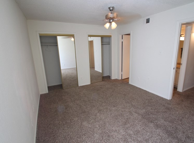 This is a photo of the bedroom of the 704 square foot 1 bedroom apartment at The Boulders Apartments in Garland, TX.