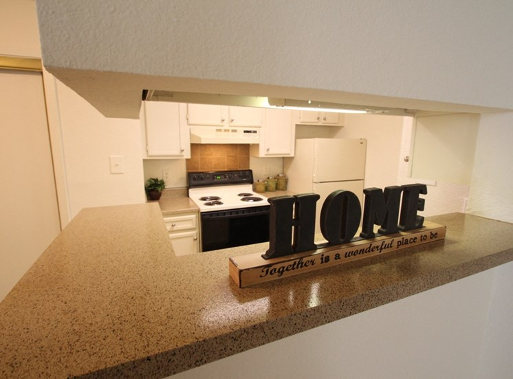 This is a photo of the kitchen of the 704 square foot 1 bedroom apartment at The Boulders Apartments in Garland, TX.