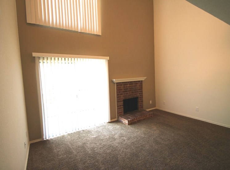 This is a photo of the fireplace in the 717 square foot 1 bedroom loft apartment at Canyon Creek Apartments in Dallas, TX