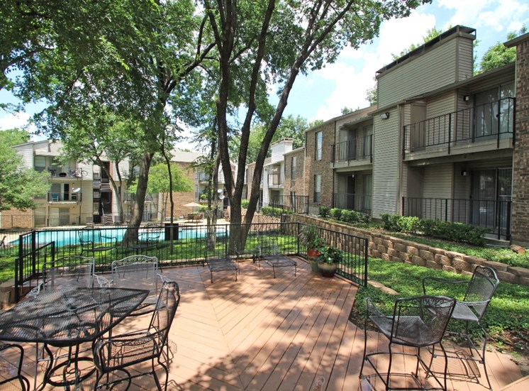This is a photo of the patio/pool area at Canyon Creek Apartments in Dallas, TX