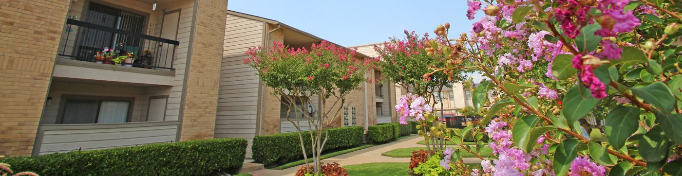 This is a picture of the grounds at Gateway Place Apartments in Garland, TX.