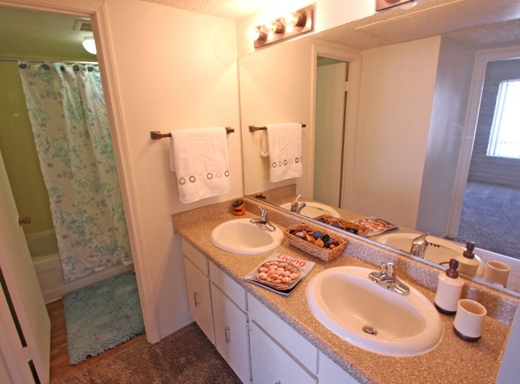 This is a photo of the bathroom in the 871 square foot 2 bedroom apartment at Harvard Square Apartments, in Dallas, TX.