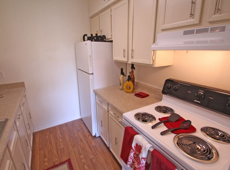 This is a photo of the kitchen in the 871 square foot 2 bedroom apartment at Harvard Square Apartments, in Dallas, TX.
