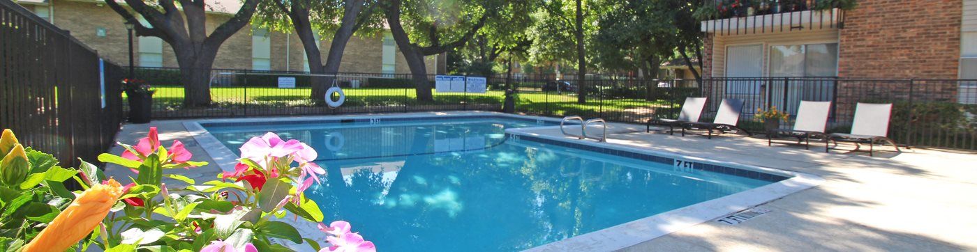 This is a photo of the pool area at Preston Park Apartments in Dallas, TX