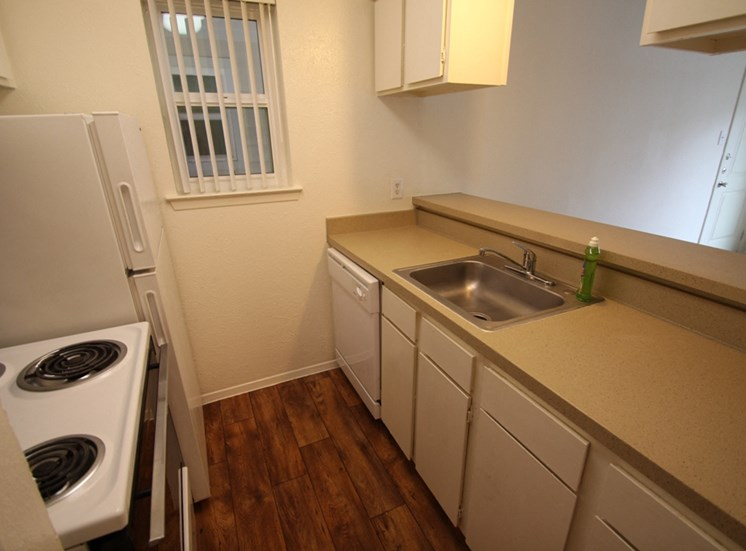 This is a photo of the kitchen in a 558 square foot 1 bedroom apartment at The Summit at Midtown Apartments in Dallas, TX.