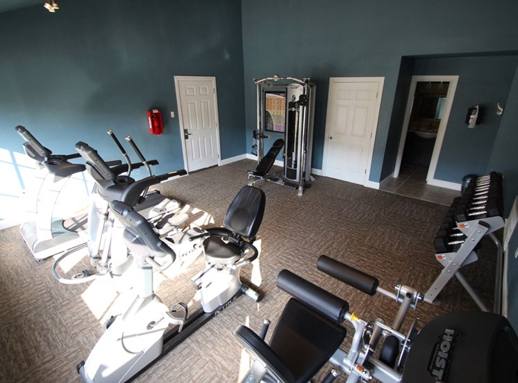 This is a photo of the fitness center showing workout machines at Woodbridge Apartments in Dallas, TX.