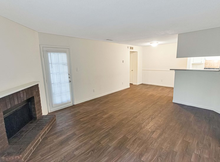 This is a photo of the living room in a 663 square foot 1 bedroom, 1 bathroom with fireplace apartment at The Boulders Apartments in Garland, TX.