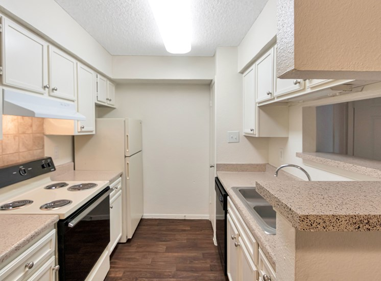 This is a photo of the kitchen in a 663 square foot 1 bedroom, 1 bathroom with fireplace apartment at The Boulders Apartments in Garland, TX.
