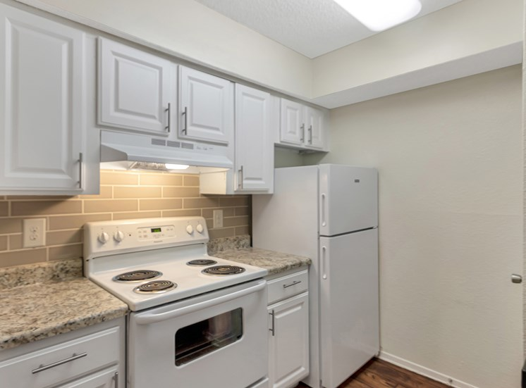 This is a photo of the kitchen in a 827 square foot 2 bedroom, 1 bathroom apartment at The Boulders Apartments in Garland, TX.