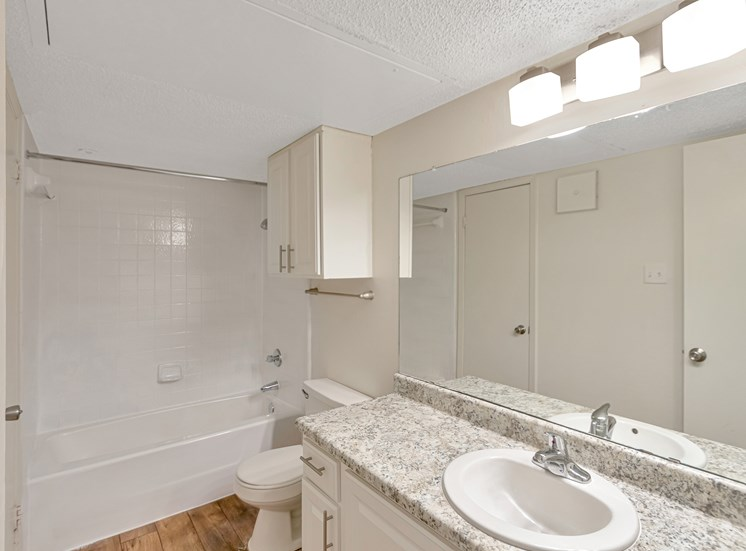 This is a photo of the bathroom in a 827 square foot 2 bedroom, 1 bathroom apartment at The Boulders Apartments in Garland, TX.