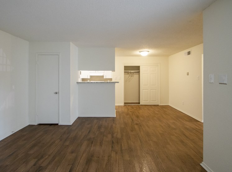 This is a photo of the living room in a 704 square foot 1 bedroom apartment at The Boulders Apartments in Garland, TX.