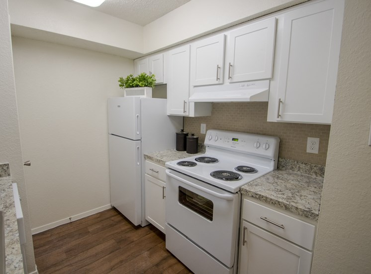 This is a photo of the kitchen in a 704 square foot 1 bedroom apartment at The Boulders Apartments in Garland, TX.