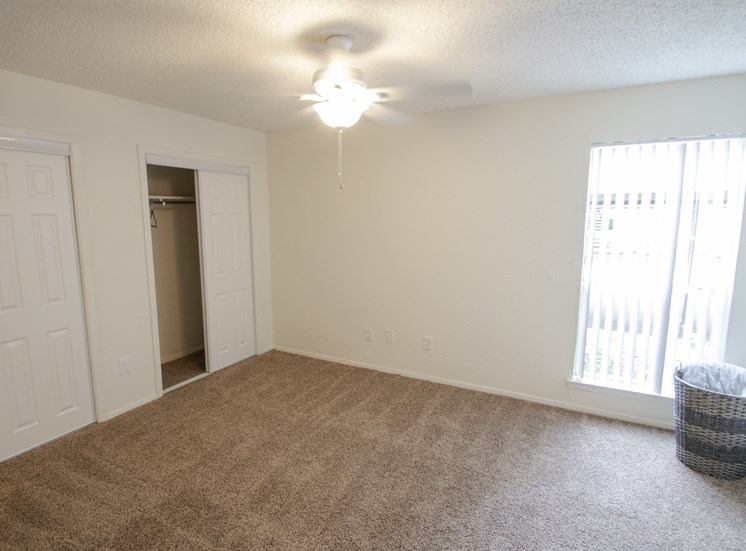 This is a photo of the bedroom in a 704 square foot 1 bedroom apartment at The Boulders Apartments in Garland, TX.